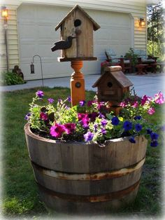 A really cute garden decorating idea with this rustic old wooden barrel ....