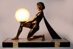 An art deco spelter lamp by Geo Maxim, France 1930s.