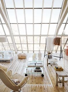 I'd love to have a portion of my home to look like a loft...Decor: long/wide (light colored) cushioned benches that surround a large square coffee table. A couple hanging plants, and exotic/tropical plants that love sun light...yes!