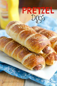 Warm soft pretzel bread twisted around our American favorite hot dog. Pretzel Dogs, Pretzel Bread, Hamburgers, Bread Twists, Good Food, Yummy Food, Pizza, Hot Dog Buns, Hot Dogs
