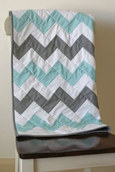 This quilt has been marked down 15%. Original price is $140.00 This aqua and gray chevron quilt is sure to be your little ones favorite blankie!