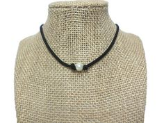 """White acrylic pearl suede leather choker necklace with extension chain    Suede Cord - 3mm width (Your Choice) Choose from many of our colored suede cord. Lots to choose from!  Length - 14"""" with 4"""" extension chain.  Acrylic pearl - 10mm diameter.  This """"suede"""" is actually made from specially treated microfibers -- it will NOT crack, weather, or smell. Just like leather, only better! Lasts longer, and it's cruelty free! This fantastic cord is used with standard type findings without breaking…"""