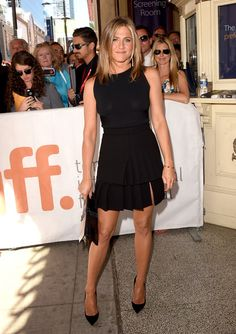 Jennifer Aniston Mini Skirt -A tiered black Emanuel Ungaro mini added a flirty touch to Jennifer Aniston's look-Jennifer Aniston flaunted her fit physique in a tight black Valentino top during the premiere of 'Cake.'
