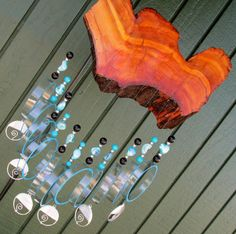Recycled Wine bottle wind chime    This wind chime is made from recycled wine bottles and is approx. 22 inches long. The bottles are hand cut and
