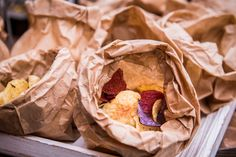 Wonderfully colourful tasty vegetable crisps served in brown paper bags catering #guidilenci Photo #Iuriniccolai All Rights Reserved GUIDI LENCI www.guidilenci.com