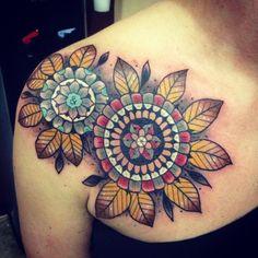 Colorful mandala style shoulder tattoo