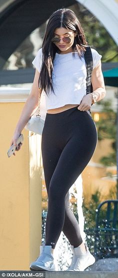 Kylie Jenner flashes her midriff in white cropped T-shirt and black leggings | Daily Mail Online