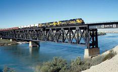 Santa Fe train symbol 876 on massive deck truss bridge over the Colorado River