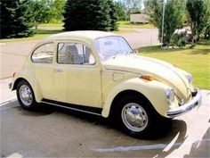 1970 Volkswagen Beetle. Mine may have been this nice once...but it was pretty dented up when I got it. And much, much shorter after the guy hit it in front of my house!