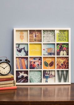 What I love about this frame is that it doesn't make you choose just one memory to show off. You can mix and match photos and words easily, or even cut out maps and postcards to put in one of the frames. The 16 mini frames allow for a homemade collage and a unique arrangement. #home #design