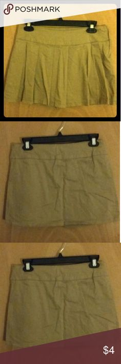 Tan/beige skort Color: tan/beige Namebrand: children's place Size: 12 plus Pleated in the front with side zipper on the left Uniform wear or just to play in Children's Place Bottoms Skorts