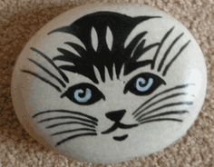 We wanna have a bucket of found smooth rocks and little paints n brushes so visitors can make one (or more!) and leave their mark on a trail of them we'll have going up along the front steps.  Galet chat by BlueMarguerite