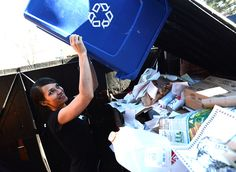 Waitress Jen Horton dumps recycling in the bins outside the Buff Restaurant on Wednesday November 25, 2014. For more photos go to www.dailycamera.com Photo by Paul Aiken / The Boulder Daily Camera