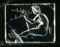 tagaoth:    Ancient Roman crystal intaglio of piping satyr -Rouen