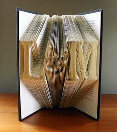 cool/unusual wedding gift:  personalized folded vintage book art