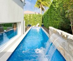 small garden ideas lap pool with water feature waterfall