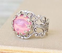 Opal ring <3Hey, I found this really awesome Etsy listing at https://www.etsy.com/es/listing/156646203/vintage-pink-opal-ringpink-glass