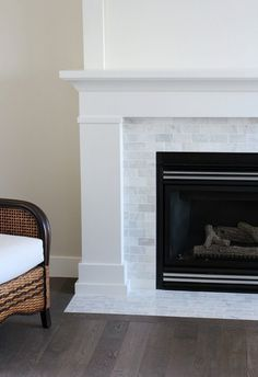 Our fireplace makeover is officially done! Come check out how we used inexpensiv.Our fireplace makeover is officially done! Come check out how we used inexpensive trim and marble subway tile to give it a fresh Fireplace Update, Small Fireplace, Fireplace Remodel, Brick Fireplace, Fireplace Surrounds, Fireplace Design, Fireplace Ideas, White Fireplace Mantels, Subway Tile Fireplace