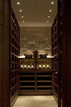 This wine cellar is a classic for a small space and will merge into our homes existing stonework in the walkout basement.