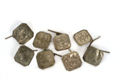 Set of eight square silver buttons decorated with incised flowers. They were made sometime in the late 19th century and they probably belonged to a gentleman's waistcoat. (Museo del Traje MT104402)