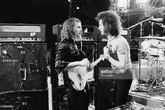 Deep Purple guitarist Ritchie Blackmore (left) on the stage with a crew member at the California Jam rock festival, Ontario Motor Speedway, Ontario, California, 6th April 1974.