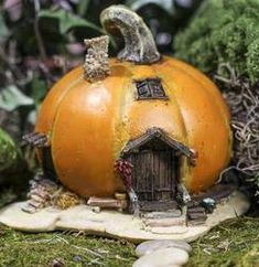 Fairy Garden Pumpkin Cottage Item# 4192  Our Price:	$19.99 Price was:	$22.99  You Save:13%   1 piece 5 inches wide 4 inches high 4 1/4 inches deep Made entirely from cold cast resin Amazing hand painted details