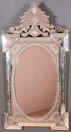 A LARGE VENETIAN ETCHED AND BEVELED GLASS WALL MIRROR : Lot 811