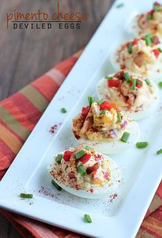 Bring a classic recipe up a notch by incorporating sharp cheddar cheese and crispy bacon bits! Pimento Cheese Deviled Eggs are a snack that's sure to satisfy at your next game-day party or holiday potluck. Yummy Appetizers, Appetizers For Party, Appetizer Recipes, Dinner Recipes, Quiches, Egg Recipes, Cooking Recipes, Tapas, Pimento Cheese