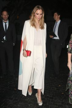 Suki Waterhouse wearing a white all-in-one and cape from Stella McCartney