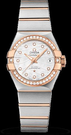 """Omega Constellation """"Pluma"""" - 27mm Stainless Steel & 18k Rose Gold. 18k Rose Gold Diamond Bezel. White Mother Of Pearl Diamond Dial Engraved With Wavy Lines To Resemble The Elegant Shape Of A Feather. The Watch Is Equipped With The Omega Caliber 8520 Self-Winding Co-Axial Movement With An Approximate Power Reserve Of 50 Hours."""