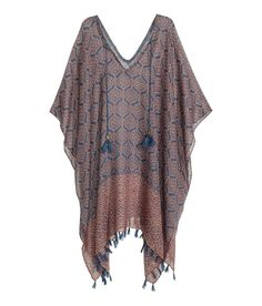 Poncho in airy woven fabric. | Warm in H&M