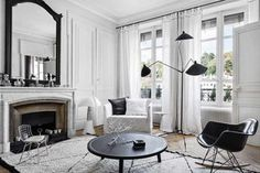 Suzanne of Melbourne-based design firm One Girl Interiors creates wonderfully warm and inviting spaces with backdrops of white and grey, pastel accents and bits of navy and black to keep things from l