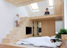 To allow parents more time in bed, Russian architecture studio Ruetemple has added a play area above the master bedroom at this summer house