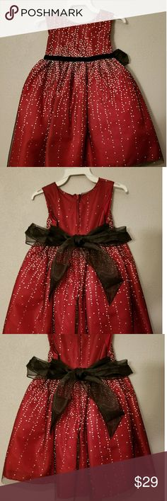 Gorgeous baby Christmas dress size 2t Gorgeous baby Christmas dress size 2t red with black ribbon that ties in the back silver glitter all over worn once quick for pictures just stunning Dresses Formal