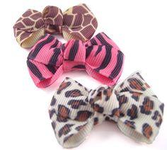 Dog Hair Bows - 3 Animal Print Dog Hair Bows - Giraffe, Zebra, Wild Cat - Yorkie Shih Tzu Maltese. $4.50, via Etsy.