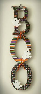 Walmart letters, modge podge and scrapbook paper-make your own cute wall or door hangings!