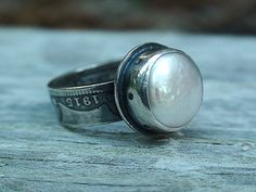 I love this ring made out of an old coin.  My birthstone too!  By haletree.