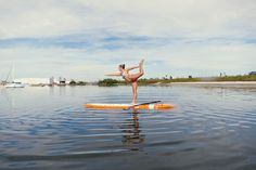 Stand up paddle board yoga: Dancer's pose.    #Paddleboardshop #paddleboard #paddleboarding
