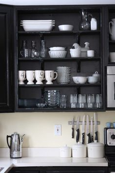 Organizing open kitchen cabinet.