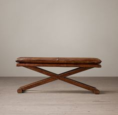 Leather X-Base Bench. One at the end of the coffee table near the tv or opposite the sofa.