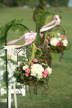 English Garden Wedding - I think these floral arrangements for the aisles are gorgeous. I think they also used these on the tables at the reception.