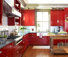 I do like the colors ~ Red Cabinets + concrete counter tops and a butcher block island, would love in teal or something too