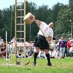 Sheaf toss - Wikipedia, the free encyclopedia Scottish Highland Games, Scottish Highlands, Irish Games, Sports Fights, Games To Play With Kids, Game Google, Guessing Games, Men In Kilts, Yard Games