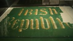 """The """"Irish Republic"""" flag, flown over the General Post Office in Dublin during the Easter Rising in Ireland, 1916 today on display in the National Museum of Ireland in Dublin."""