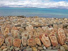 Carved Buddhist Mani Stones - Lake Manasarovar, Tibet   A mani stone is a stone or rock inscribed with Om Mani Padme Hum, the mantra of Avalokiteshvara, the bodhisattva of compassion.