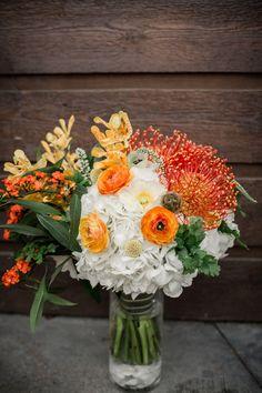 orange tropical bouquet - photo by Grey to Blue Photography http://ruffledblog.com/tropical-west-coast-inspired-wedding