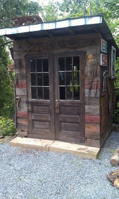 Garden Shed made from salvaged/recycled/reclaimed wood & materials made by Bradley of Old World Arhchitecual in Asheville. Love the wood siding!: