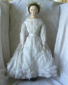 Beautiful German Wax over Papier Mache Doll with Cloth Body and Wooden Arms