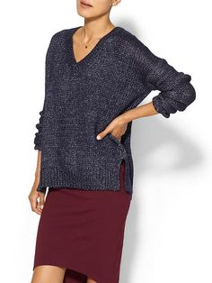 love how easy and chic this navy metallic v-neck sweater is