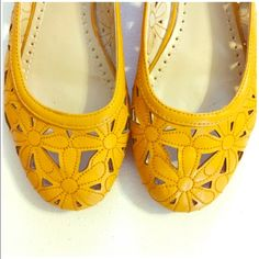 Adrienne Vittadini Laser Cut Floral Ballet Flat 6 Adrienne Vittadini Yellow Laser Cut Floral Ballet Flat --- Size 6 --- leather upper ---  laser cut floral detailing ---  round toe ---  rubber sole --- these shoes are in very good condition, worn once --- very little wear on sole --- there is a nick in the leather on the toe of the left shoe as pictured in the fourth image --- thank you for visiting my boutique, please feel free to ask any questions  Adrienne Vittadini Shoes Flats & Loafers